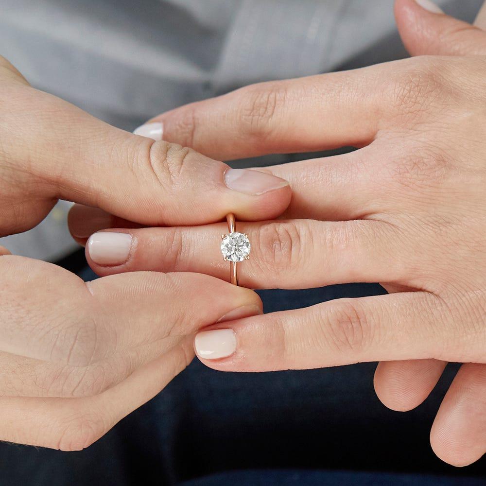 man proposing with lab grown diamond