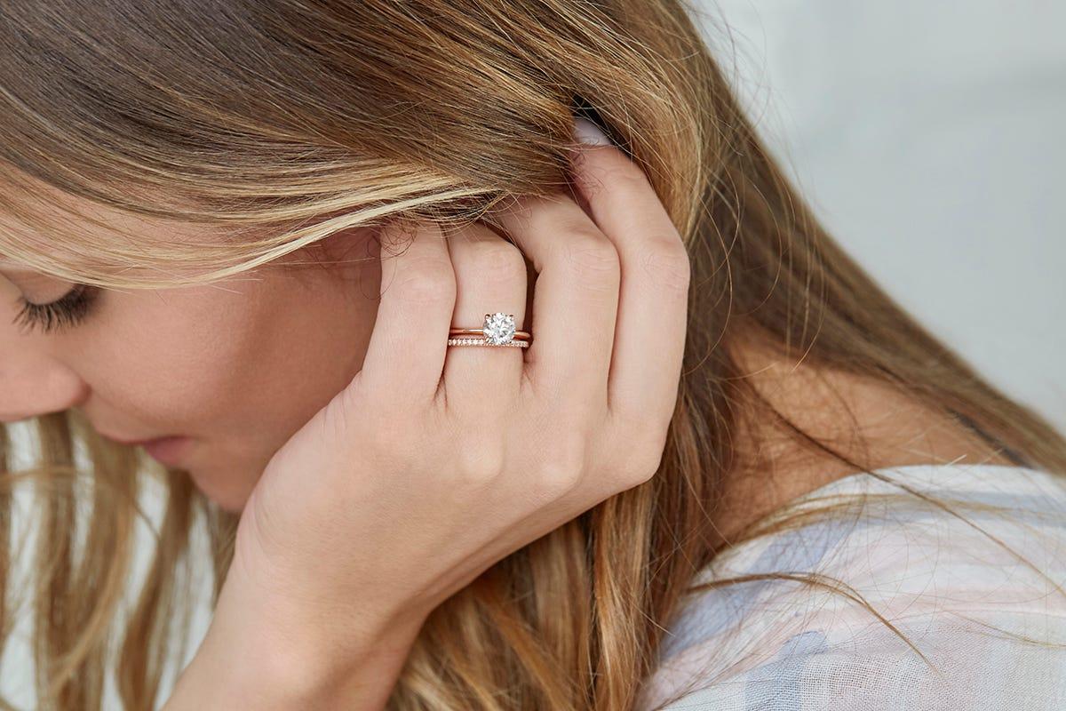 woman wearing rose gold engagement ring
