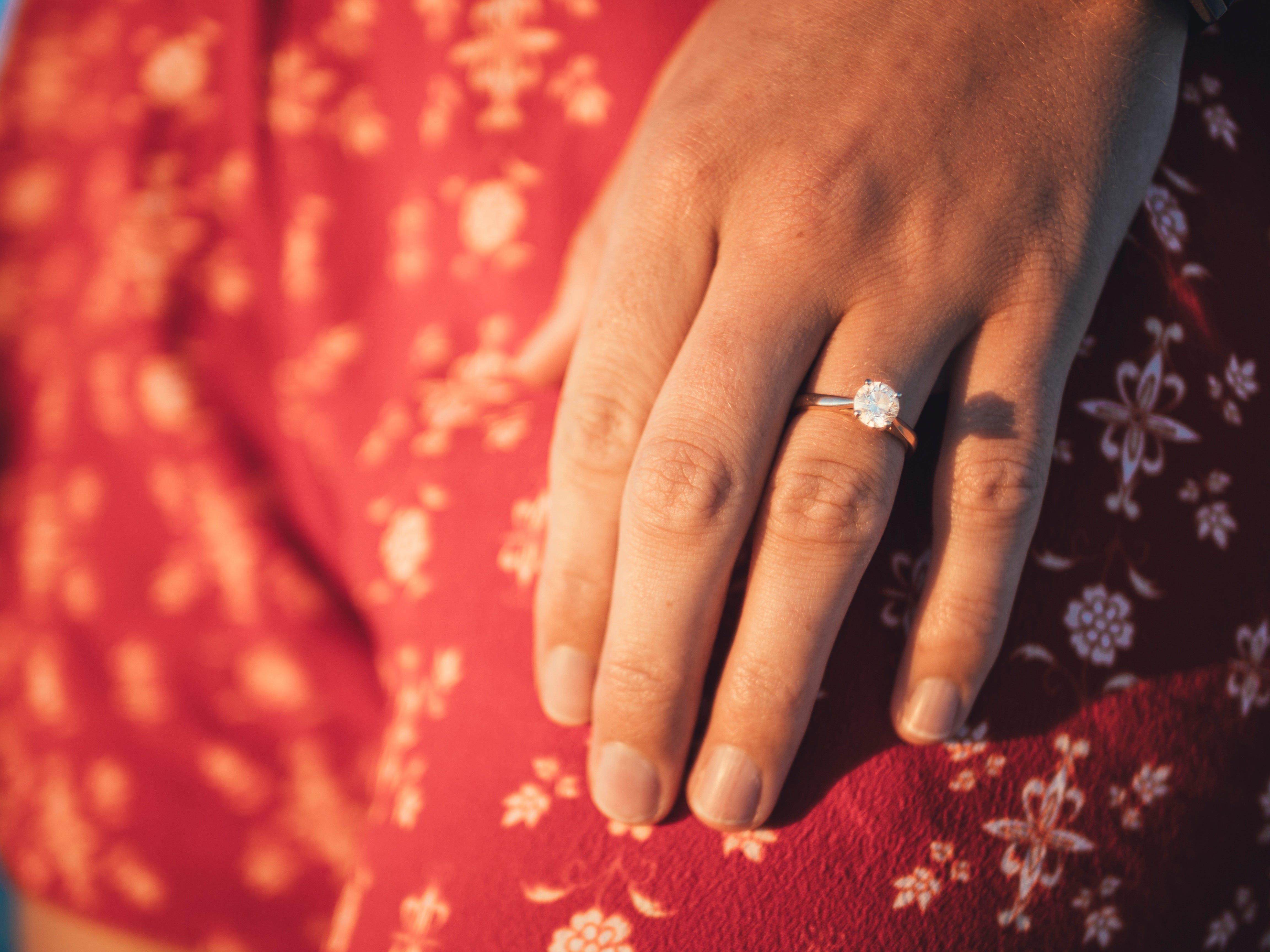 woman wearing solitaire engagement ring