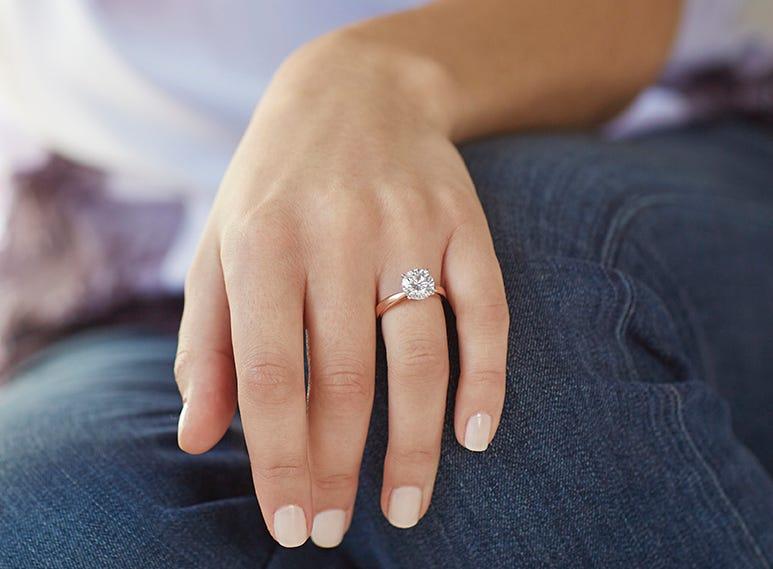 rose gold man made diamond engagement ring