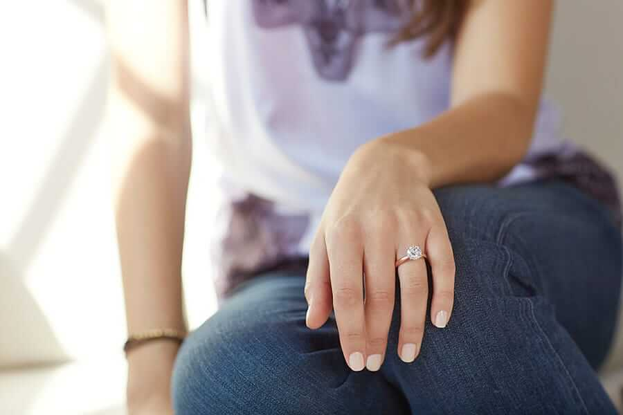 woman wearing rose gold engagement ring