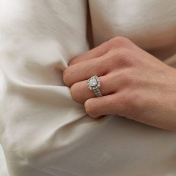 woman wearing halo style lab grown diamond engagement ring