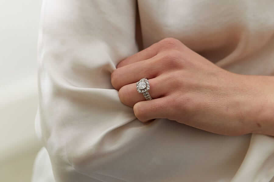 woman wearing halo style lab grown diamond engagement ring