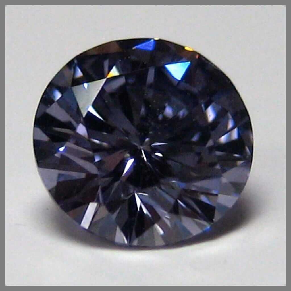 A violet diamond with a greyish hue.