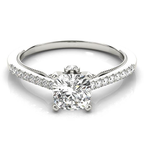 white gold engagement ring with cushion shaped diamond