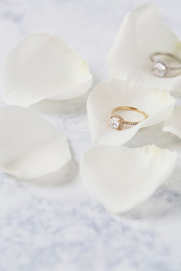 yellow gold cushion shaped diamond ring in rose petal