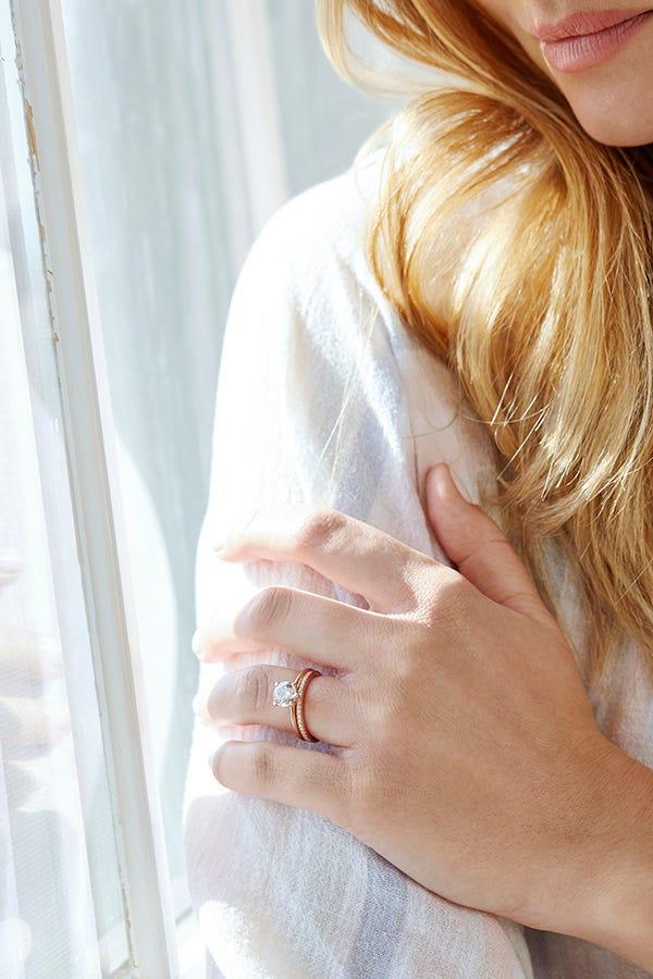 woman wearing lab created diamond bridal set