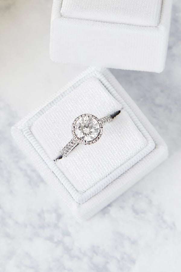 halo diamond engagement ring in box