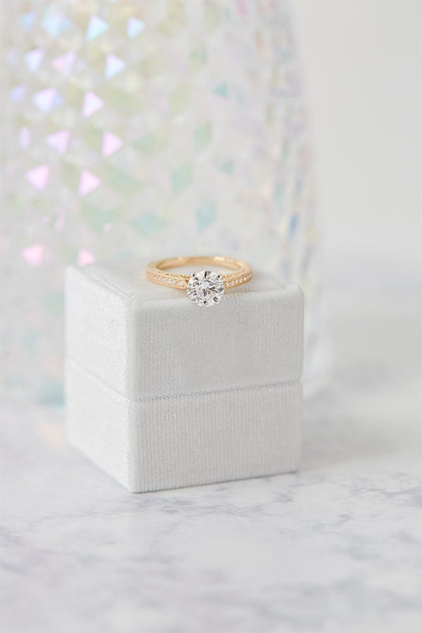 vintage engagement ring on box